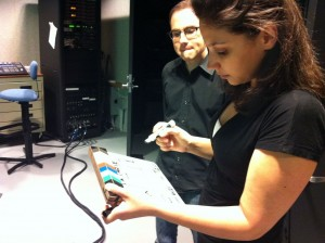 Robert Farrell (Coordinator of Information Literacy & Assessment) and Allie Verbovetskaya (Instructional Technologies Librarian) writing scene/take information on a clapperboard